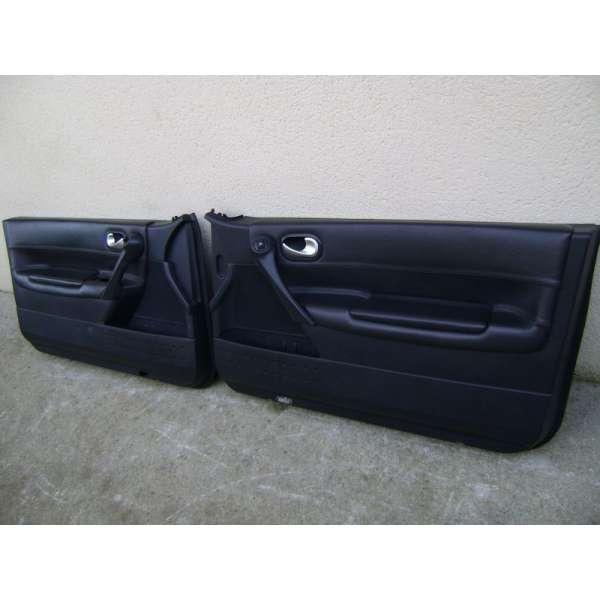 Garniture panneau de portes interieur cuir noir renault for Porte interieur noir
